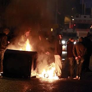 A burning barricade on the Newtownards road area of Belfast, where police have been targeted by rioters