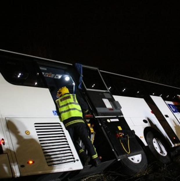 A coach carrying 26 passengers overturned while travelling on on the M3 southbound a mile from Fleet services
