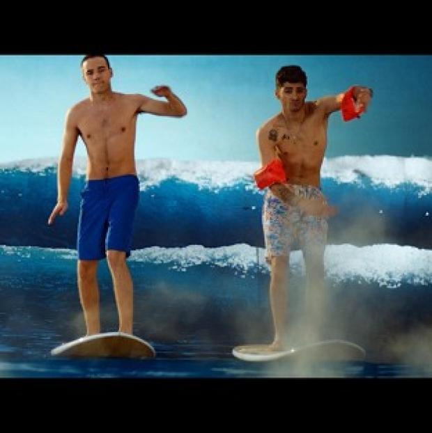 One Direction's new video sees them shirtless and surfing