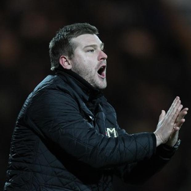 MK Dons boss Karl Robinson is wanted by managerless Blackpool