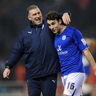 Nigel Pearson, left, was delighted with the win which propelled Leicester to second