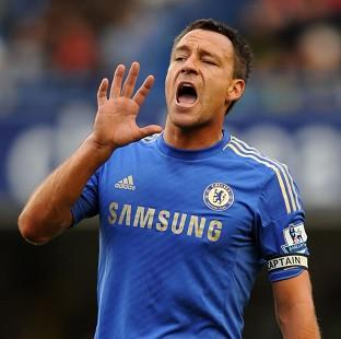 John Terry, pictured, will lift Chelsea, according to boss Rafa Benitez