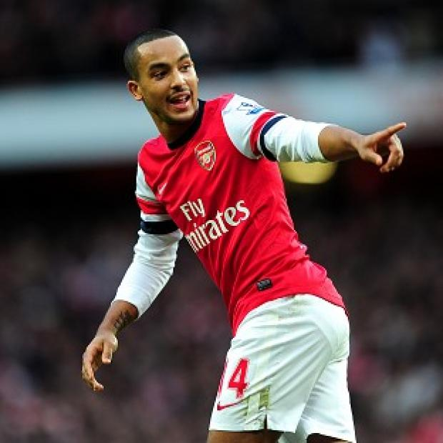 Theo Walcott insists it is 'all about the present' after sorting his contract saga