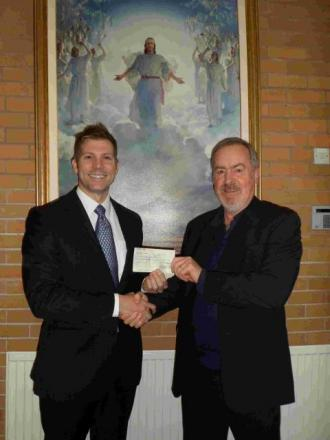 Brother John Beck (left) presents a cheque to Roger Outlaw, one of Winchester Churches Nightshelter's directors