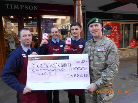 Hampshire Chronicle: Timpson staff Scotty Tallack, Simon Baker and Gordon Murphy present the cheque to Sgt Maj Ben Culleton