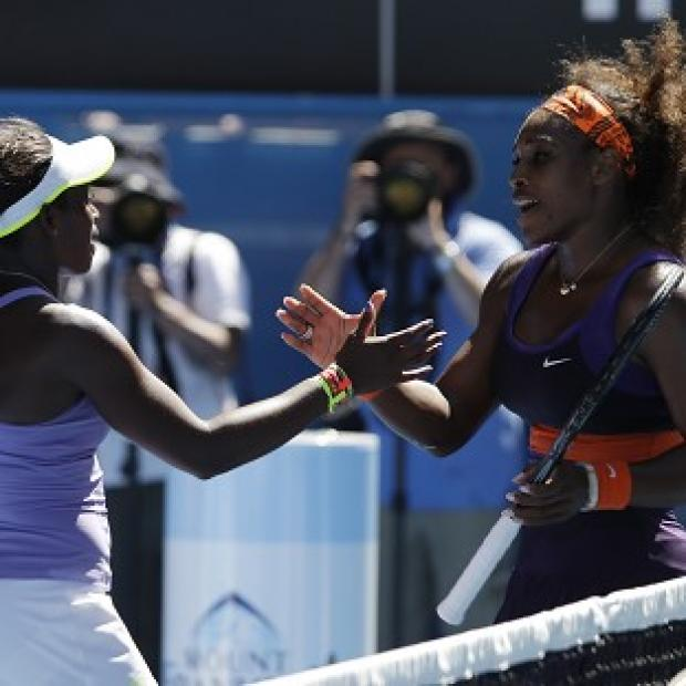 Sloane Stephens, left, is congratulated by Serena Williams after winning their quarter-final match (AP)