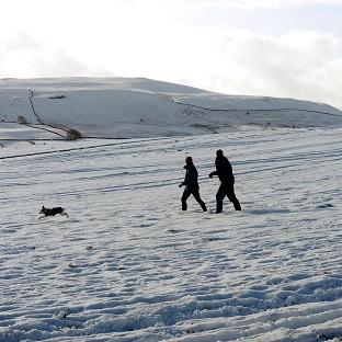 Hampshire Chronicle: Walkers in the snow as they cross Middleham Moor in The Pennines