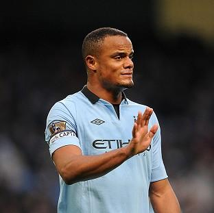 Manchester City are waiting to learn the extent of a calf injury suffered by Vincent Kompany