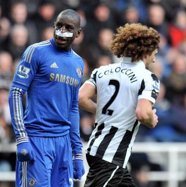 Demba Ba, left, sustained a broken nose in a challenge with Fabricio Coloccini