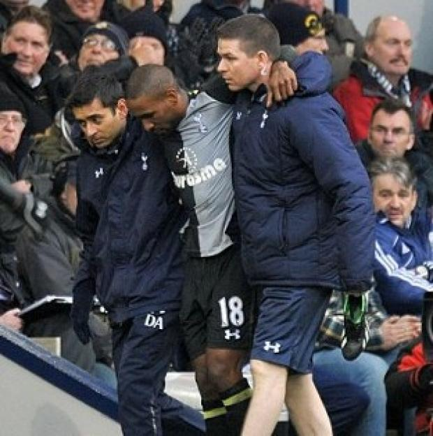 Jermain Defoe, centre, leaves the pitch with an injury