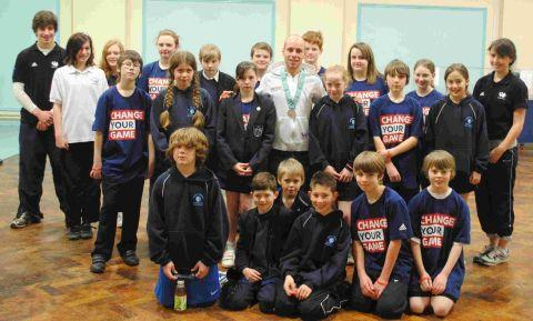 Olympic diver Pete Waterfield with members of the Sky Sports Club at Perins School