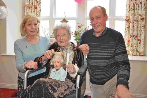 Lilian Jeffrey (centre) celebrating her 105th birthday last year with son David and daughter-in-law Angela