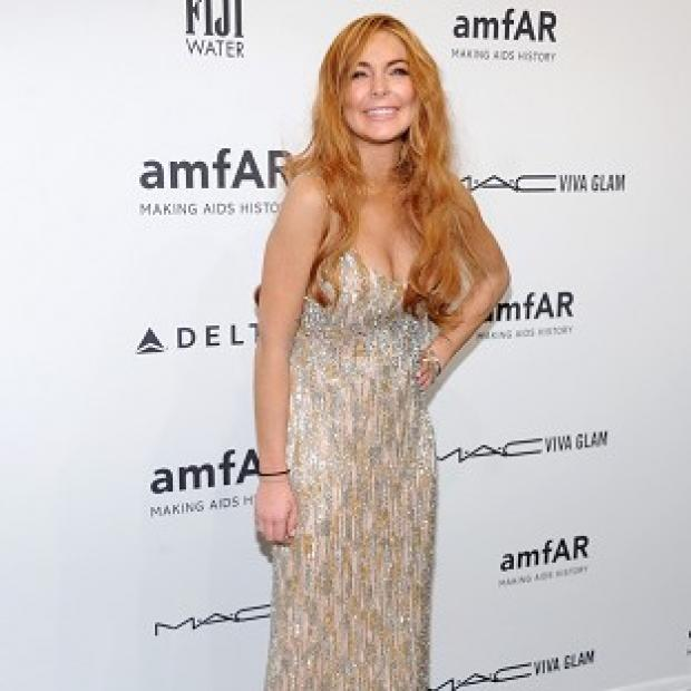 Lindsay Lohan got her amfAR frock with a little help from Charlie Sheen