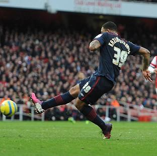 Colin Kazim-Richards scored the only goal as Arsenal were dumped out of the FA Cup