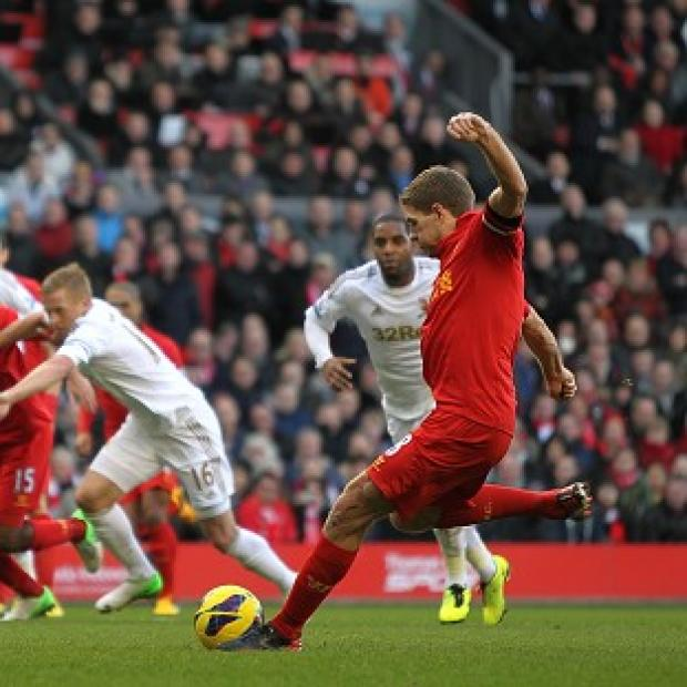 Steven Gerrard, right, kick-started Liverpool's fine display with a first-half penalty