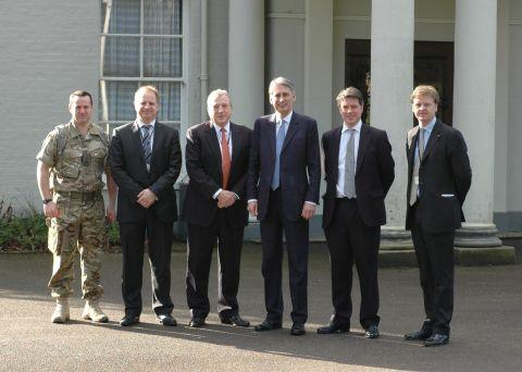 Roke managing director Stephen Grinham (third left) and defence secretary Philip Hammond (third right) with colleagues at the visit
