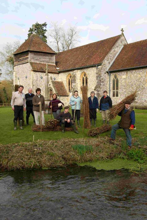 Volunteers from the Worthy Conservation Group prepare to clear the river at St Swithun's Church, Headbourne Worthy
