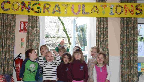 Children at Montessori Nursery School in Bramdean celebrate their outstanding Ofsted result