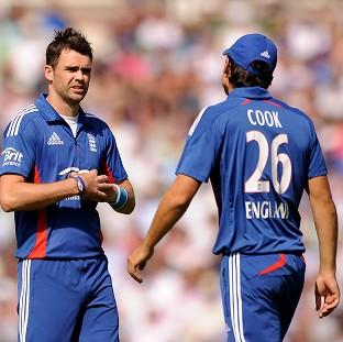 James Anderson, left, has been hailed his captain Alastair Cook