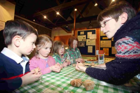 Children learn how to make bread at Winchester City Mill