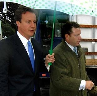 Tory backbencher Karl McCartney, right, pictured with PM David Cameron