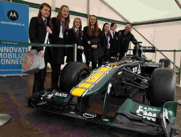 Everest Community Academy students admiring a Caterham F1 car