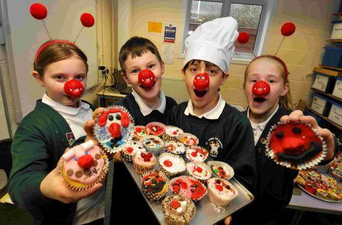 St John the Baptist Primary pupils get their Red Nose Day efforts underway with a bake-off. Picture by Sean Dillow
