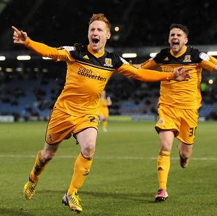 Stephen Quinn, left, celebrates scoring Hull's winner against Burnley