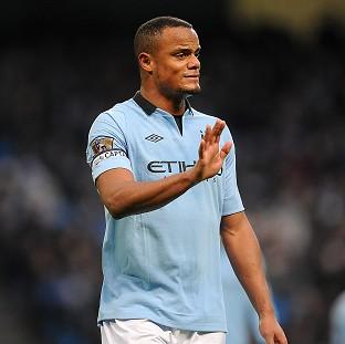 Vincent Kompany has been occupying the sidelines with a knee injury