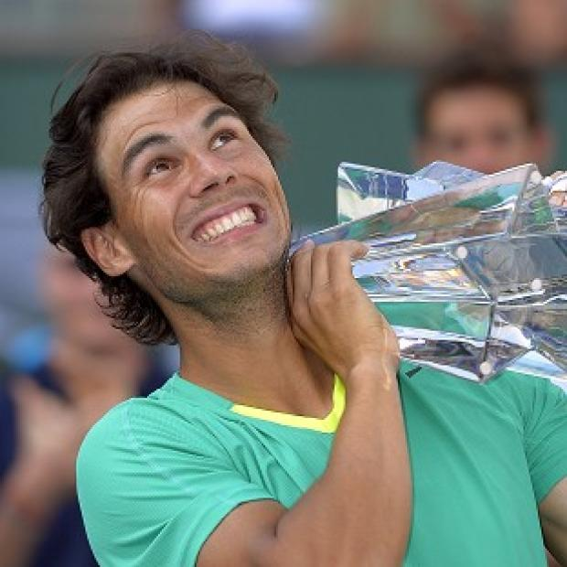 Rafael Nadal poses with the trophy after defeating Juan Martin del Potro (AP)