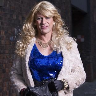 Sean Bean playing the part of school teacher Simon Gaskell's alter ego, Tracie Tremarco, in the courtroom drama Accused