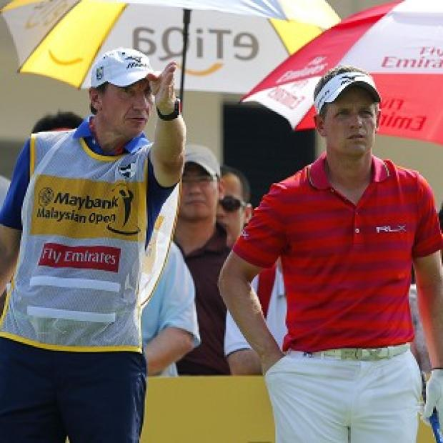 Luke Donald, right, carded a disappointing first-round 74 in Kuala Lumpur (AP)