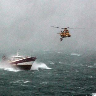 An RAF search and rescue helicopter from A Flight, 22 Squadron, attends a French trawler in atrocious weather in the Irish Sea (PA/MOD)