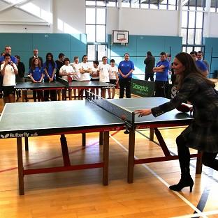 Hampshire Chronicle: The Duke and Duchess of Cambridge play table tennis at the Donald Dewer Leisure Centre in Glasgow (PA)