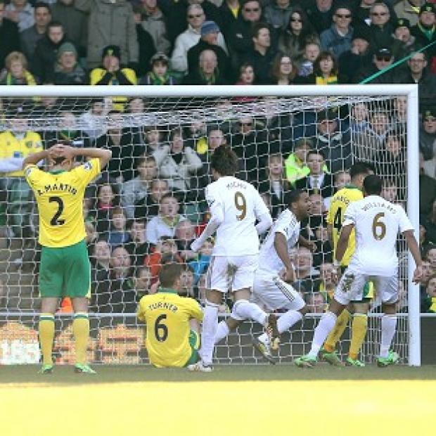 Hampshire Chronicle: Luke Moore, centre, nets Swansea's equaliser