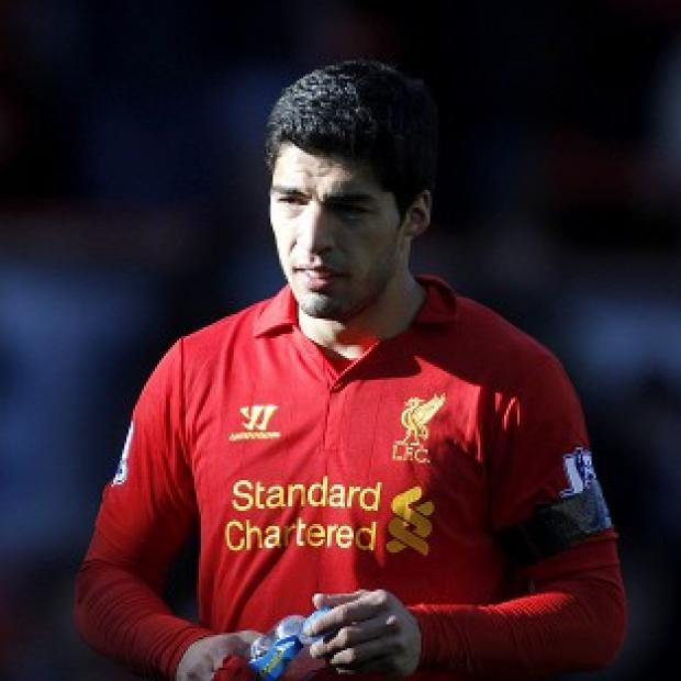 Hampshire Chronicle: Luis Suarez, pictured, bit Chelsea's Branislav Ivanovic at the weekend