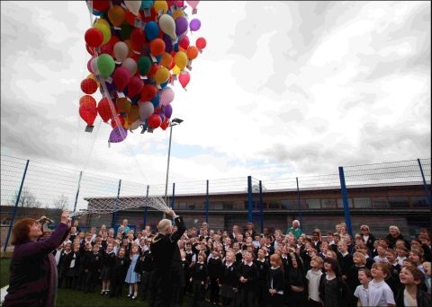 Mayor of Winchester Frank Pearson and Cllr Therese Evans launch the balloons at Wickham Primary School