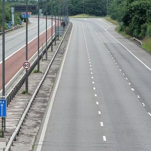 The M9 was closed for several hours after a boy's body was found on the motorway