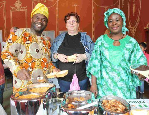 Hampshire Chronicle: Diana Wearn, centre, joins Olu Fajuyitan and Elizabeth Jaiyoela for some Nigerian food