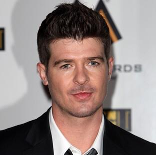 Robin Thicke's four-week reign at the top of the singles chart has come to an end