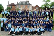 Twyford School pupils and headmaster Dr Steve Bailey celebrate the school's inspection results
