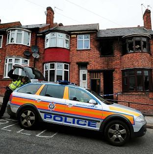 Police have charged a man in connection with a house fire which killed four people in Leicester