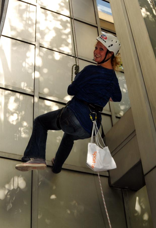 Hampshire Chronicle: Becky Holmes from AXA Wealth's press office abseiling down the firm's Basingstoke head office