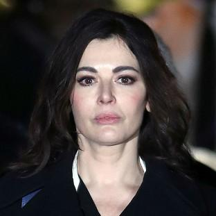 TV cook Nigella Lawson leaving court after giving evidence.