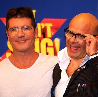 Hampshire Chronicle: Simon Cowell is said to be missing the launch of the X Factor musical, written by Harry Hill