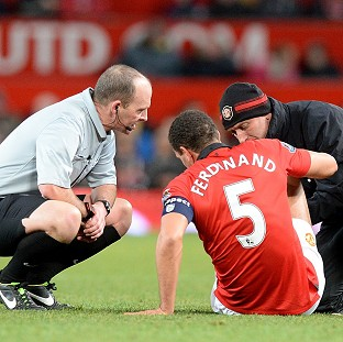 Rio Ferdinand could miss the next two weeks with a knee injury
