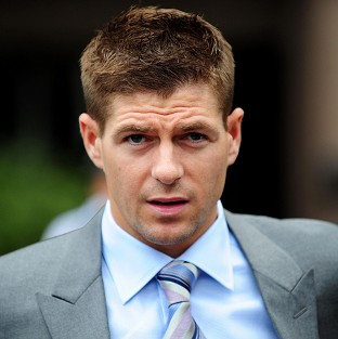 A policewoman has appeared in court in connection with an alleged disturbance near the home of Liverpool and England footballer Steven Gerrard