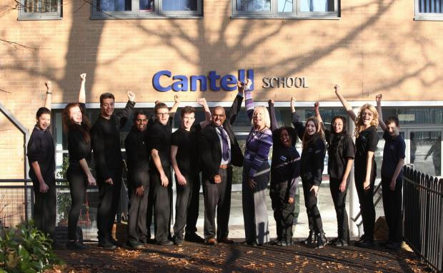 Cantell School's deputy head Harry Kutty, head Ruth Evans and pupils celebrate their Ofsted report.