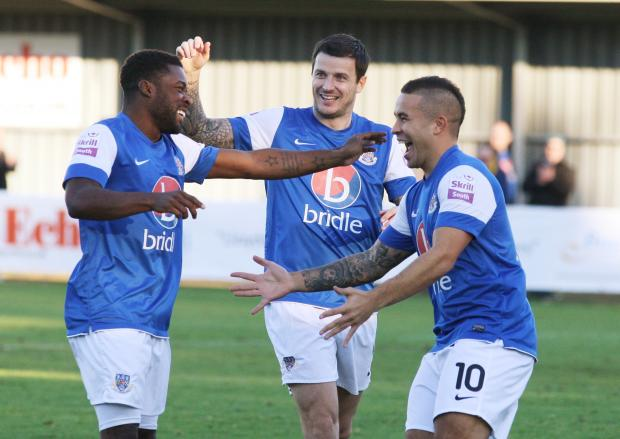 Hampshire Chronicle: Eastleigh players celebrate their side's first goal against Dover