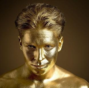Hampshire Chronicle: Joey Essex is painted gold in a promotion for PizzaExpress